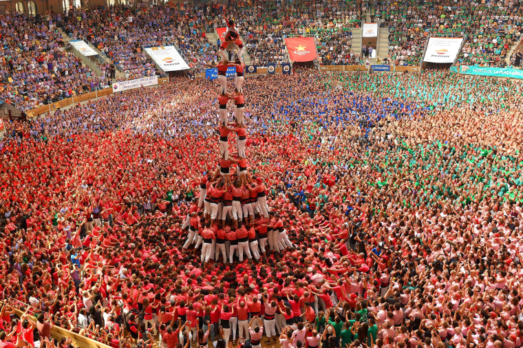 Image: TOPSHOT-SPAIN-CATALONIA-HUMAN-TOWERS-CASTELLERS