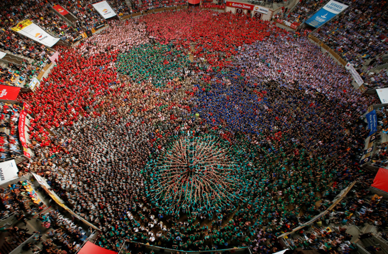 """Image: Castellers de Vilafranca form a human tower called \""""castell\"""" during a biannual competition in Tarragona city"""