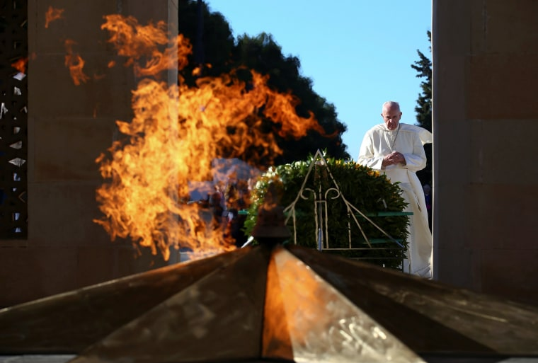 Image: Pope Francis prays in front of the monument to the fallen for the Indipendence in Ganjlik