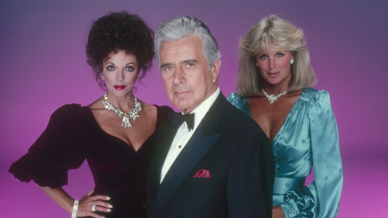 "Joan Collins, John Forsythe and Linda Evans in ""Dynasty."""