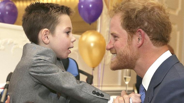 Prince Harry  with Ollie Carroll, a WellChild award recipient.