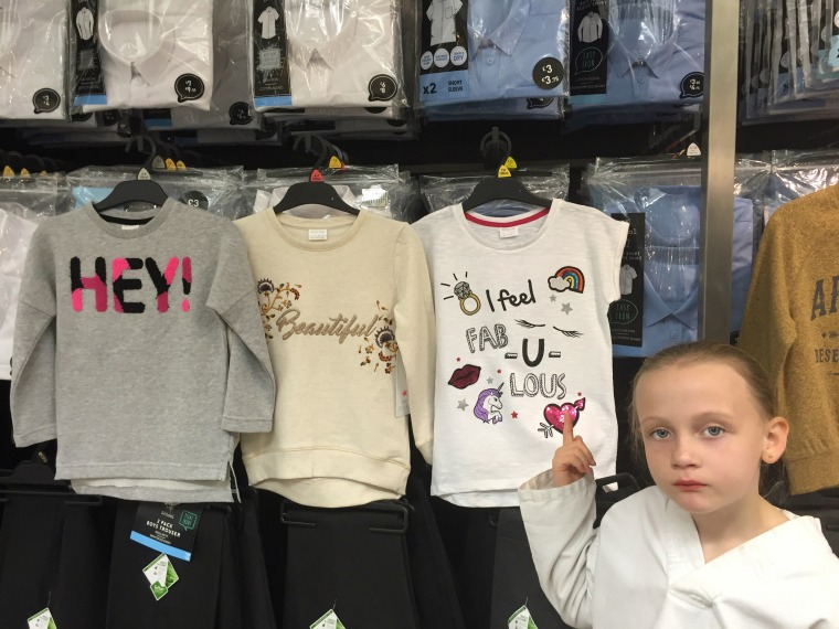 """The T-shirts for girls bore entirely different messages from the ones for boys — about feeling """"beautiful"""" and """"fabulous."""""""