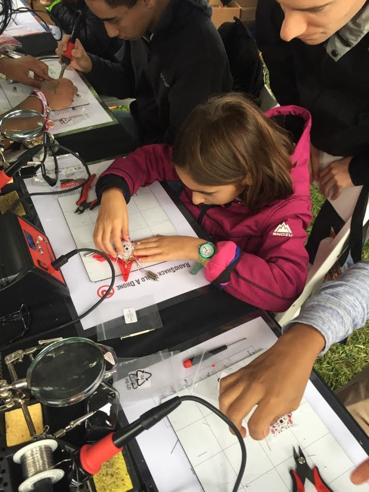 An attendee at Maker Faire creates her own drone with help from Radio Shack.