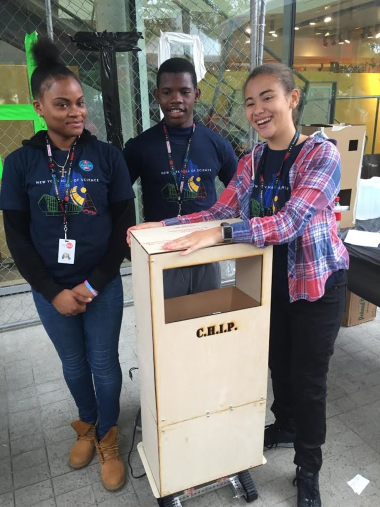 Students pose with their invention at Maker Faire.
