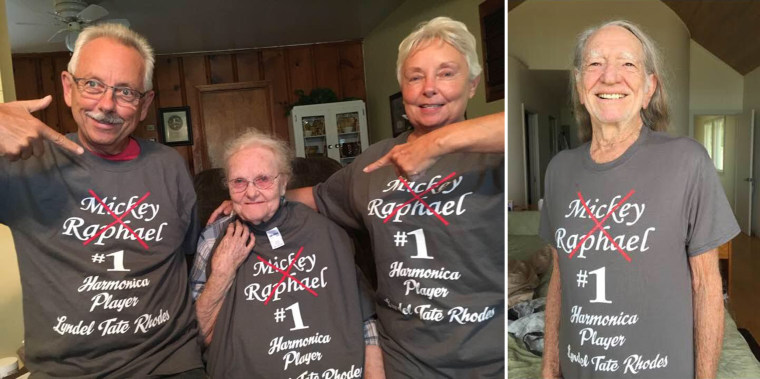 Willie Nelson and Lyndel Rhodes with her kids sporting a shirt calling her a better harmonica player than Nelson's band mate, Mickey Raphael.