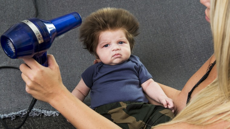 This baby has a huge head of hair