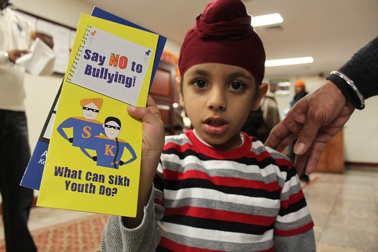 A Sikh-American student holds educational resources to help prevent bullying.