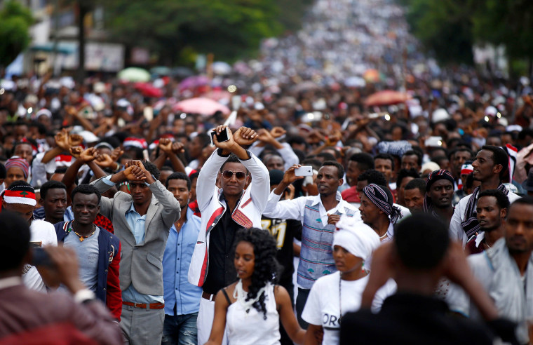 Image: Demonstrators show the Oromo protest gesture sign during Irreecha, the thanks giving festival of the Oromo people in Bishoftu town of Oromia region, Ethiopia