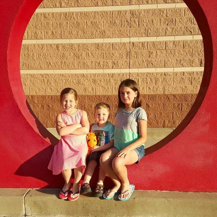 Carter Roberts and his two sisters before he was diagnosed with acute flaccid myelitis.