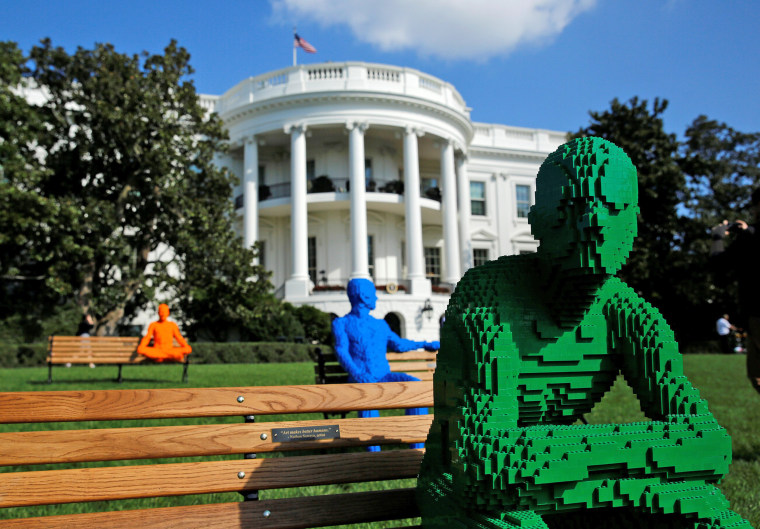 Image: LEGO statues for the South by South Lawn Festival are seen at the White House in Washington