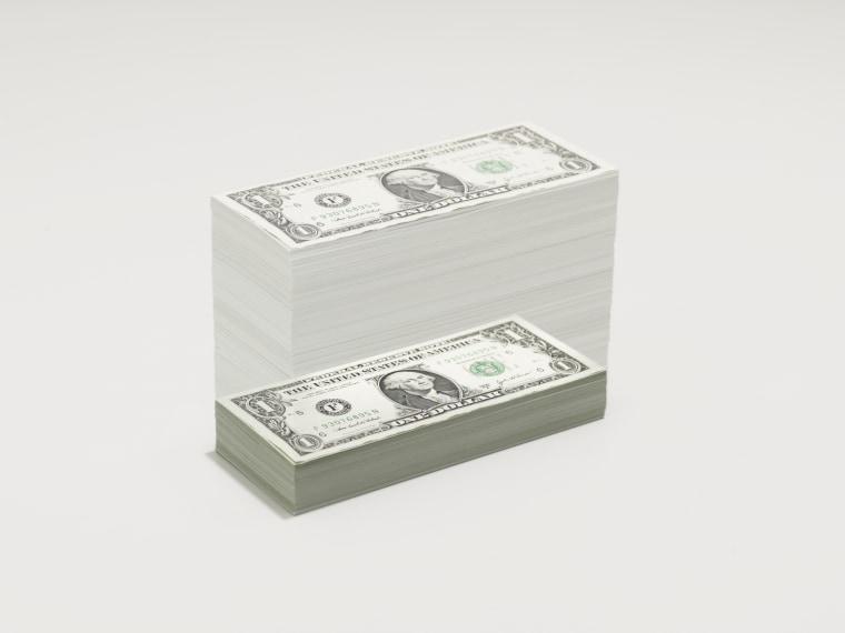 A growing pile of dollar bills