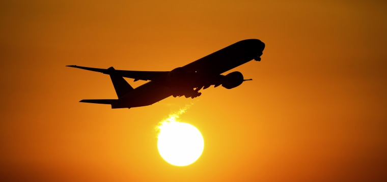 An airplane starts into the sunset from the airport in Frankfurt/Main, Germany, 23 August 2013.