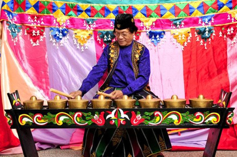 """Danongan """"Danny"""" Kalanduyan, a 1995 NEA National Heritage Fellow, playing the Kulintang gongs in his NEA portrait."""
