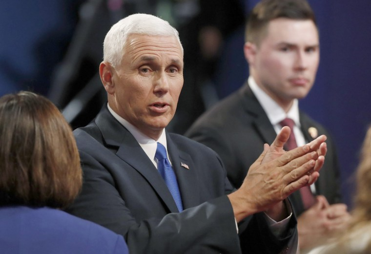 Image: Republican U.S. vice presidential nominee Governor Mike Pence claps as he talks to the audience after the conclusion of the vice presidential debate against Democratic U.S. vice presidential nominee Senator Tim Kaine at Longwood University in Farmv