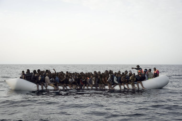 Image: Migrants wait to be rescued by members of Proactiva Open Arms NGO