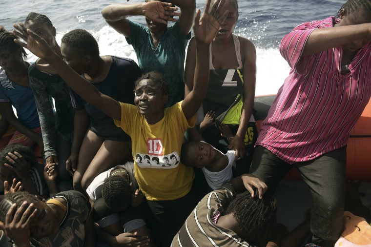 Image: Migrants react as they are being rescued by members of Proactiva Open Arms NGO