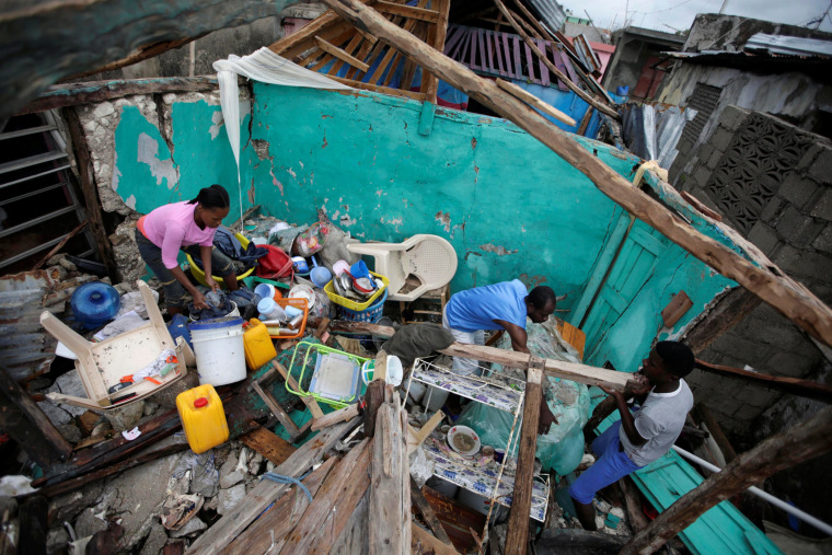 Image: Residents work clearing a house destroyed by Hurricane Matthew in Les Cayes