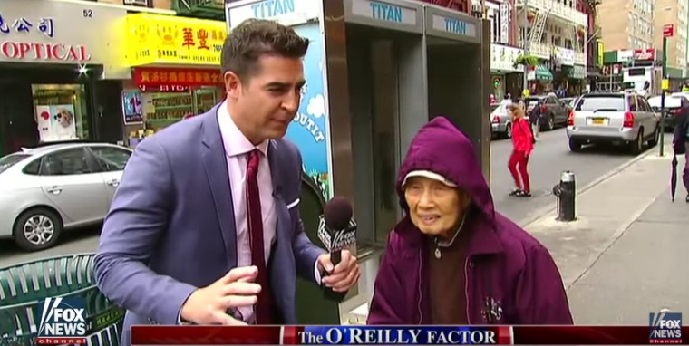 """The screenshot from a recent Fox News segment shows correspondent Jesse Watters interviewing people in New York City's Chinatown about the 2016 election and China-U.S. relations. Civil rights organizations and the Asian American Journalists Association have criticized the segment for promoting """"racist and offensive stereotypes."""""""