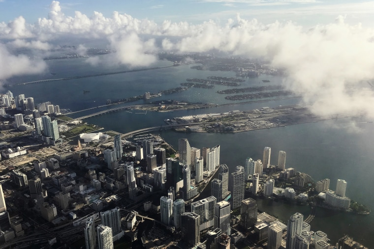 Image: Downtown Miami is pictured in this aerial photo as clouds begin to form in advance of Hurricane Matthew in Miami