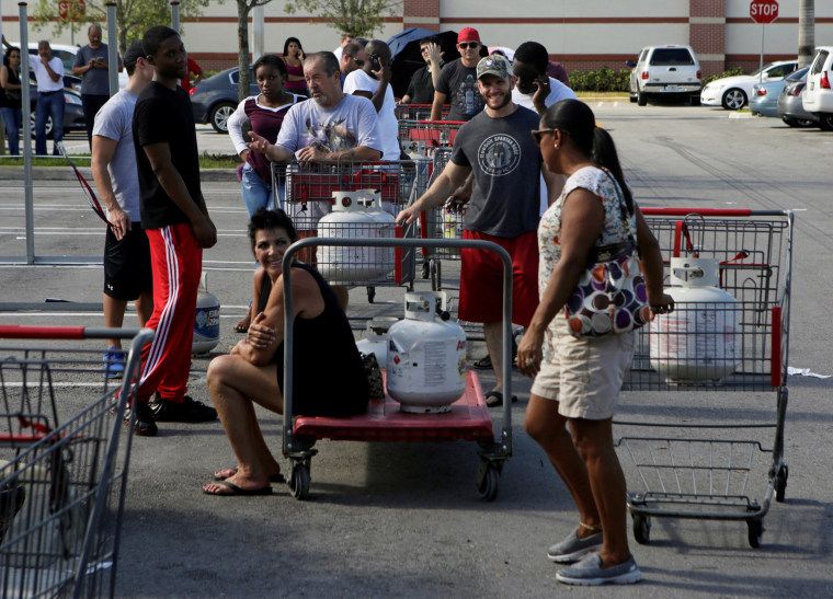 Image: People line up to fill their LP propane gas cylinders in anticipation of Hurricane Matthew, in Coral Springs