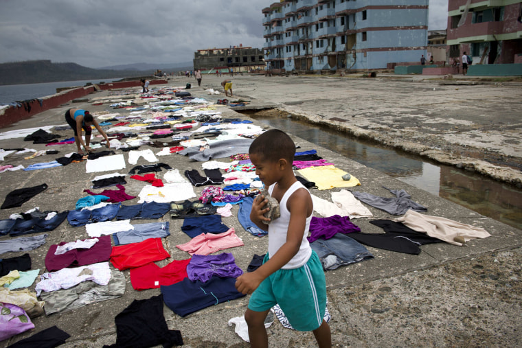 Image: People dry their clothes on the waterfront in Baracoa, Cuba