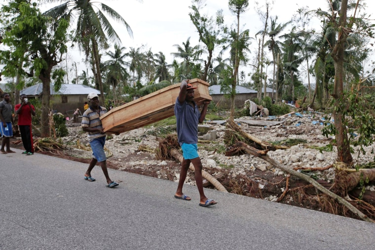 Image: Men carry a coffin after Hurricane Matthew hit Cavaillon, Haiti