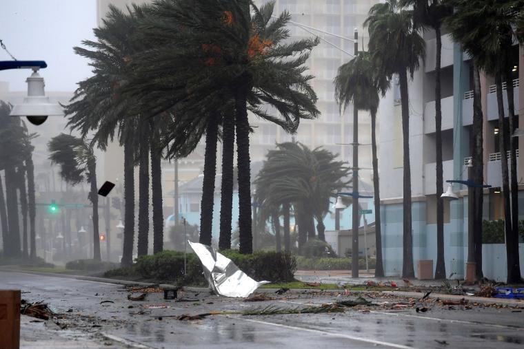 Image: Debris flies through the air as the eye of Hurricane Matthew nears Daytona Beach