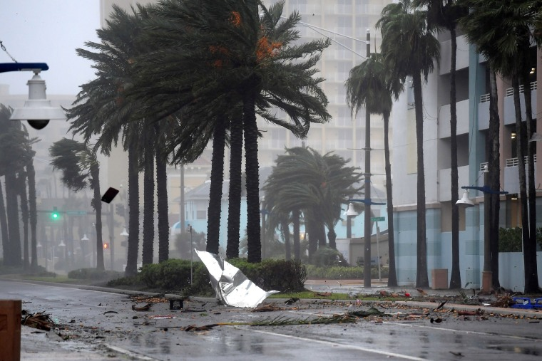 Image: Debris flies through the air as the eye of Hurricane Matthew nears Daytona Beach