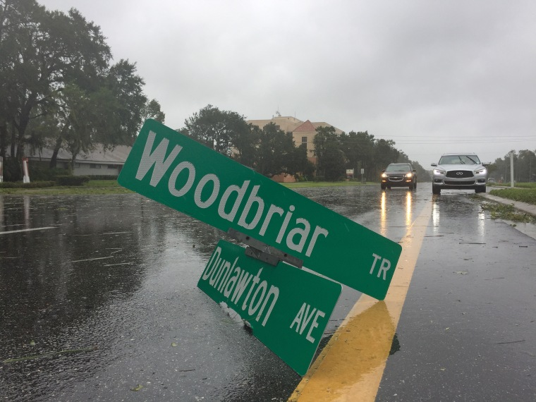 A street sign lies in the road on Oct. 7 in Daytona Beach, Florida, after the area was hit by powerful winds from Hurricane Matthew.