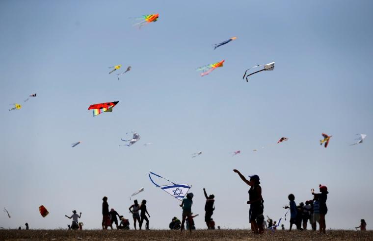 Image: Israelis fly kites during Rosh Hashanah holiday