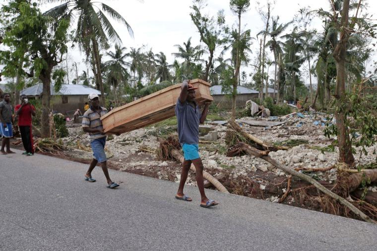 Image: Men carry a coffin after Hurricane Matthew hit Cavaillon, Haiti
