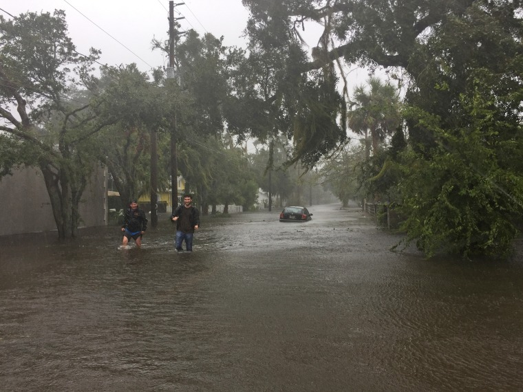 Two men walk through floodwaters in historic Saint Augustine on Bayview Drive on Oct. 7 as Hurricane Matthew worked its way up the Florida coast.
