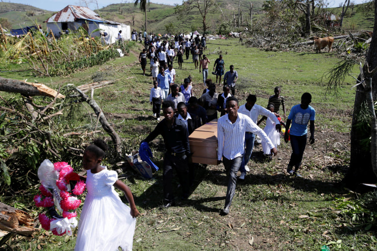 Image: Friends and relatives attend the funeral of Anne Dit Trozitha Zamore, who died during Hurricane Matthew, in Chantal, Haiti