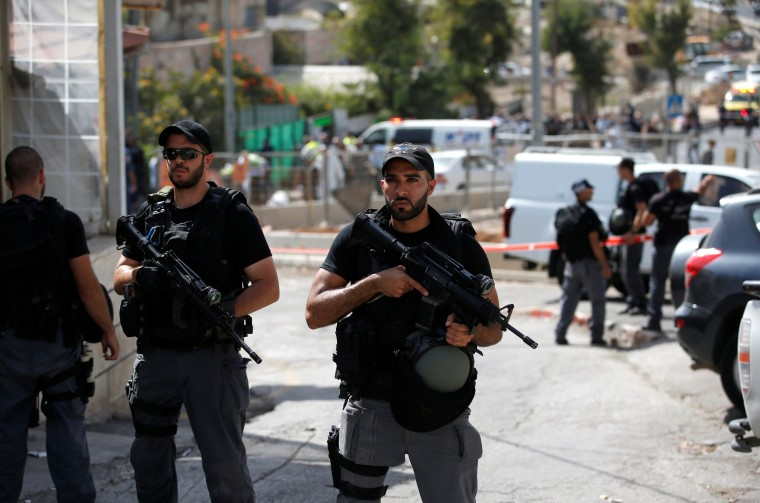 Image: Israeli riot police secure the area following a shooting in Jerusalem early Sunday.