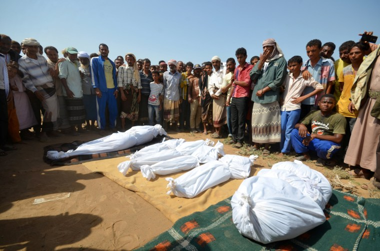 Image: People stand by the coffins of members of the same family killed one day after they were killed by a Saudi-led air strike on their house in Bajil district of the Red Sea province of Houdieda, Yemen