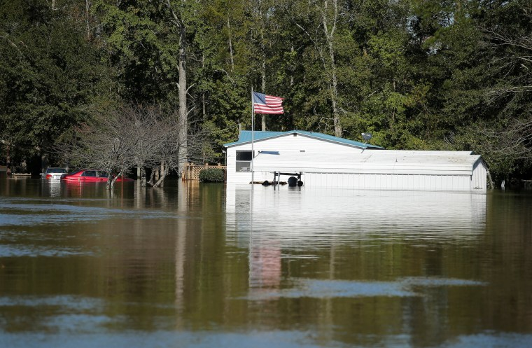 Image: A home is seen as flood waters rise after Hurricane Matthew in Lumberton