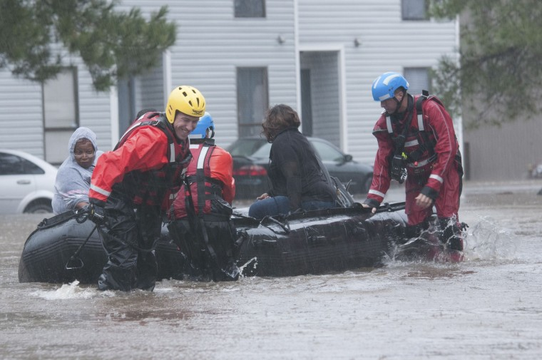 Image: North Carolina emergency services evacuate residents of a neighborhood that fell victim to the flooding caused by Hurricane Matthew in Fayetteville