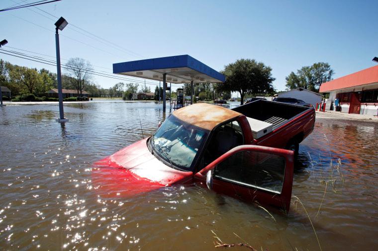Image: An abandoned truck lies in submerged waters after Hurricane Matthew hit Lumberton, North Carolina