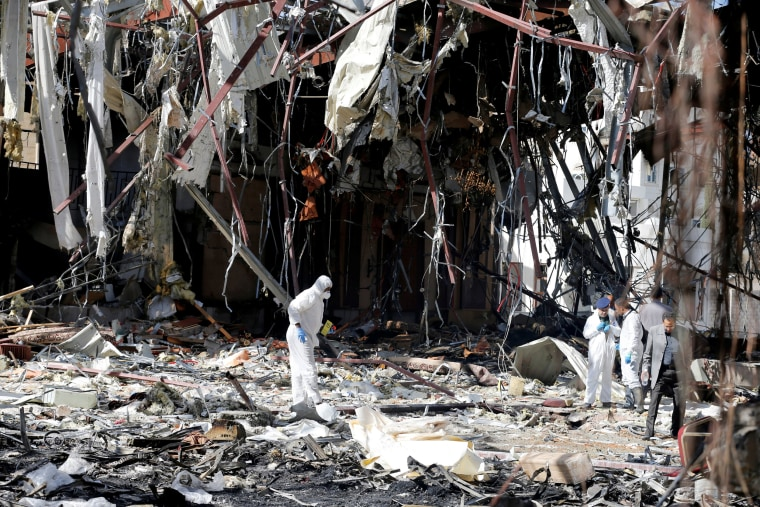 Image: Forensic experts investigate the scene at the community hall where Saudi-led warplanes struck a funeral in Sanaa, the capital of Yemen