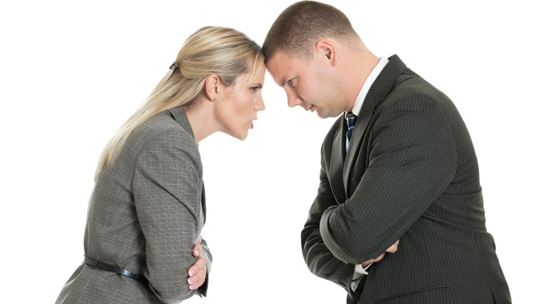 Angry male and female business people butting heads