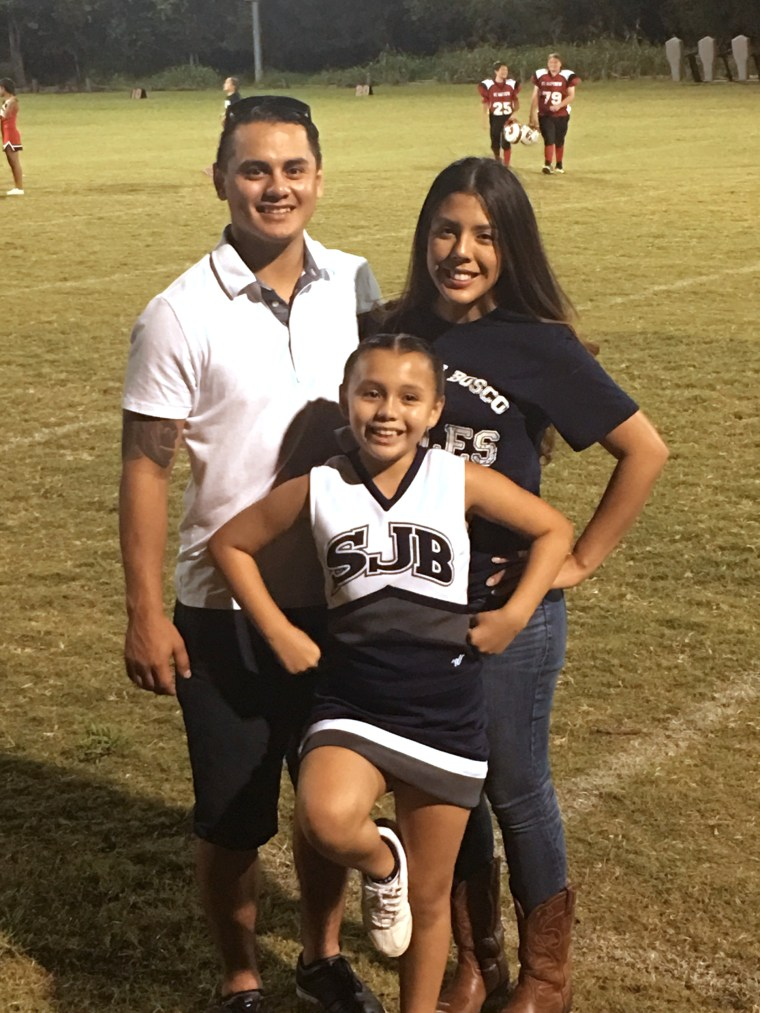 Cheerleader helped by hs student
