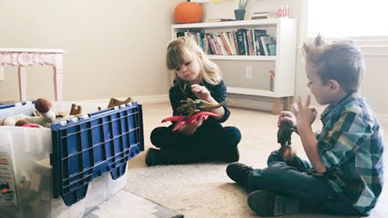 kids playing with their not-at-all-sad box of toys