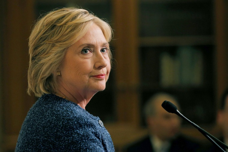 """Image: U.S. Democratic presidential candidate Hillary Clinton speaks to reporters after holding a """"National Security Working Session"""" with national security advisors in New York"""