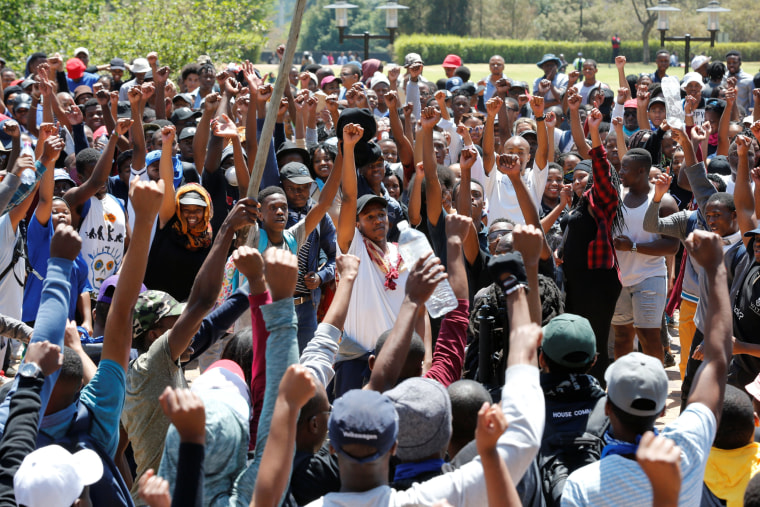 Image: Demonstrators gesture during protests by students demanding free education at the Johannesburg's University of the Witwatersrand, South Africa