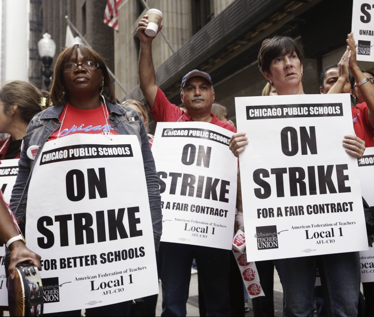 Image: Chicago Teachers Union members picket outside of the CPS headquarters in Chicago