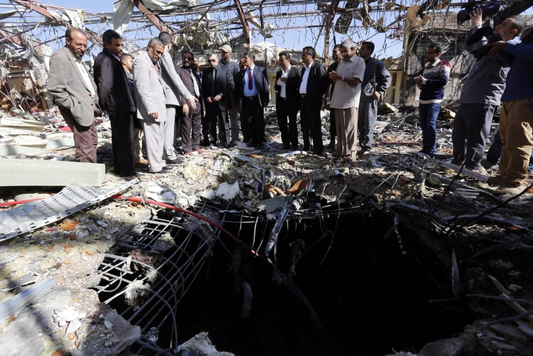 Image: Russian diplomats visit destroyed funeral hall in Sana'a