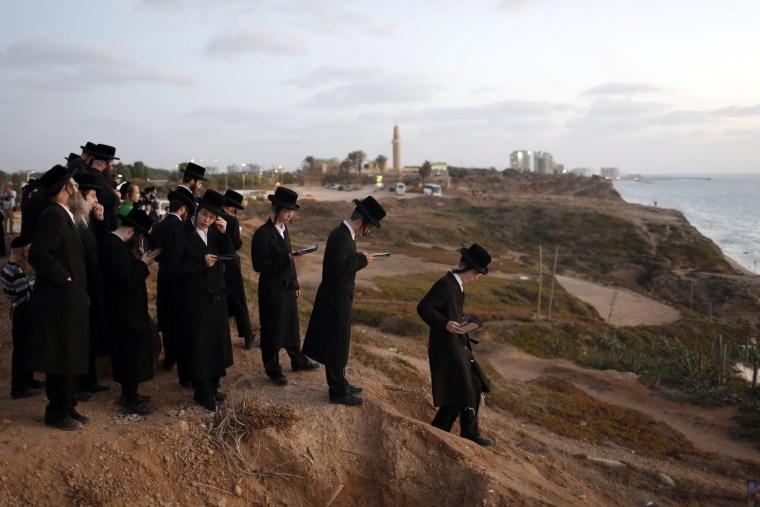 Image: Tashlich ritual at the Herzliya beach outside Tel Aviv, Israel