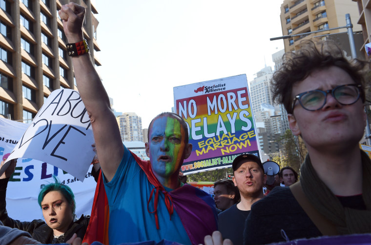 Image: Pro-gay marriage supporters shout for their rights during a rally in Sydney