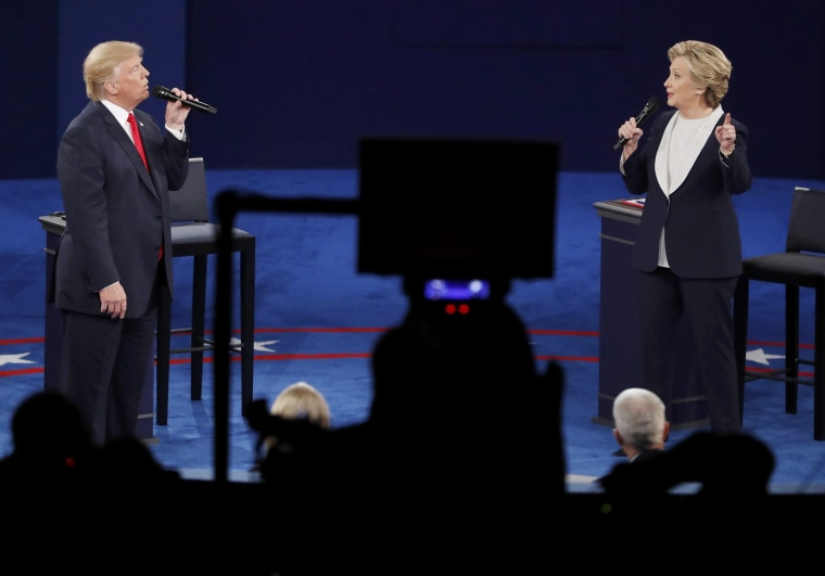 Image: Republican U.S. presidential nominee Donald Trump and Democratic U.S. presidential nominee Hillary Clinton speak during their presidential town hall debate at Washington University in St. Louis
