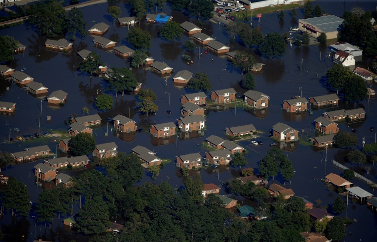 Image: An aerial view shows a neighborhood that was flooded after Hurricane Matthew in Lumberton, North Carolina